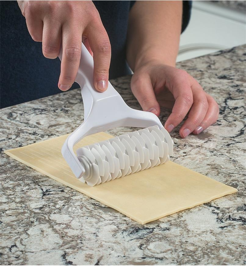 Lattice Cutter being rolled through dough on a countertop