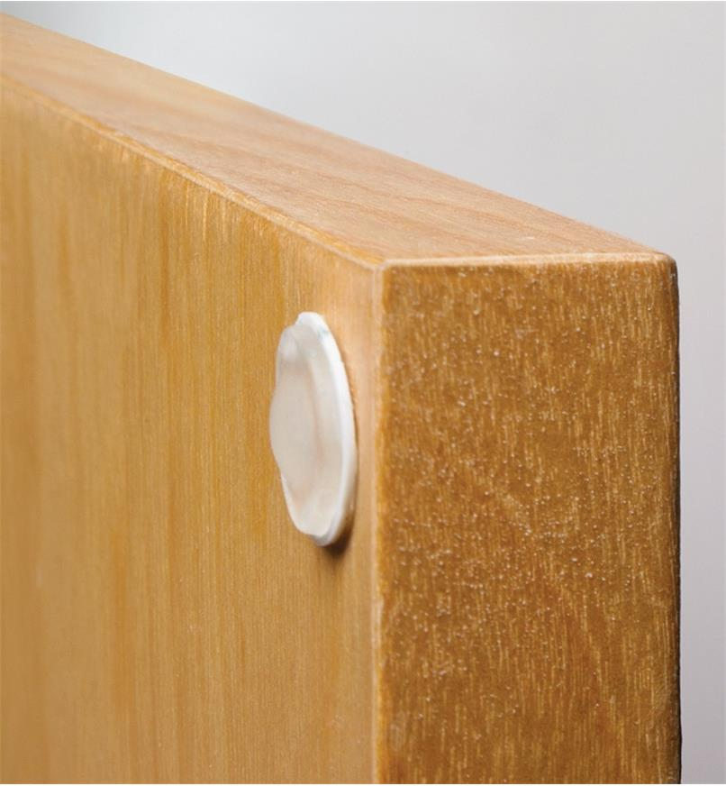 Press-In Soft Bumper mounted to the inside corner of a cabinet door