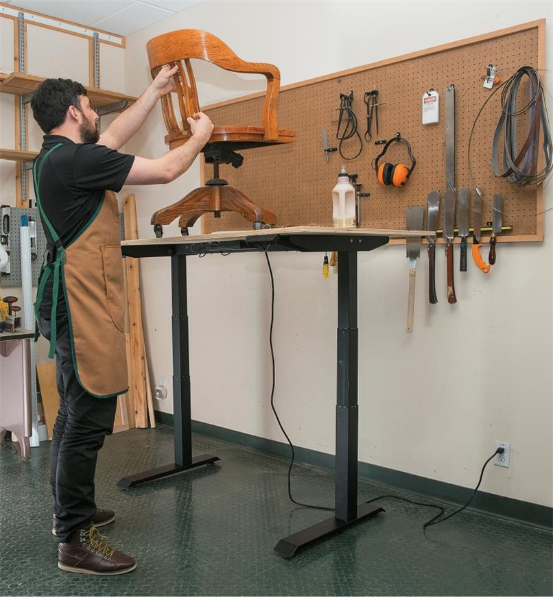 Motorized Table Lift used to support a work surface in a workshop