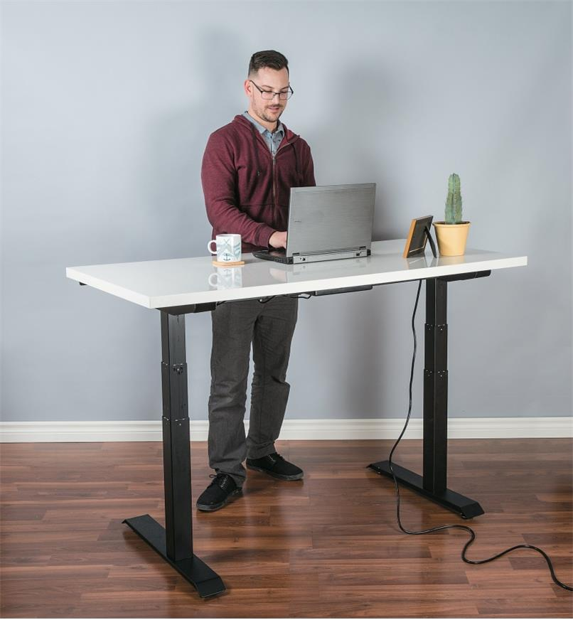 Motorized Table Lift used to support a stand-up desk in an office