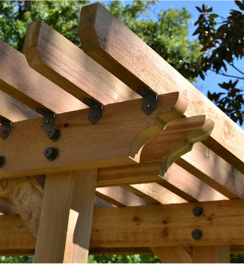 """Ozco 2"""" Rafter Clips installed on a pergola"""