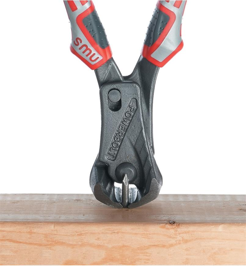 Cutting the end of a nail flush with lumber using the high-leverage end-cutters