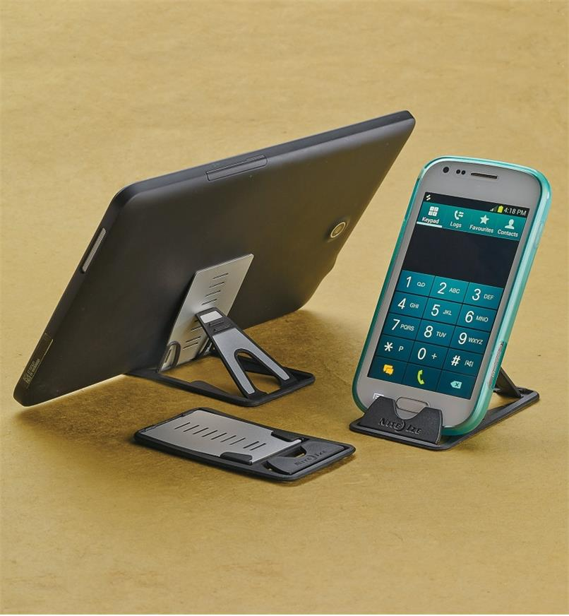 Two QuikStands holding a phone and a tablet, beside a third Quickstand not in use