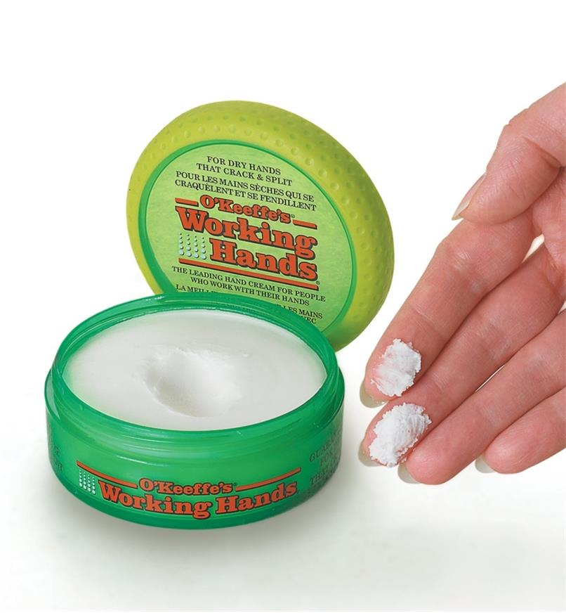O'Keeffe's Working Hands Cream on a person's fingertips