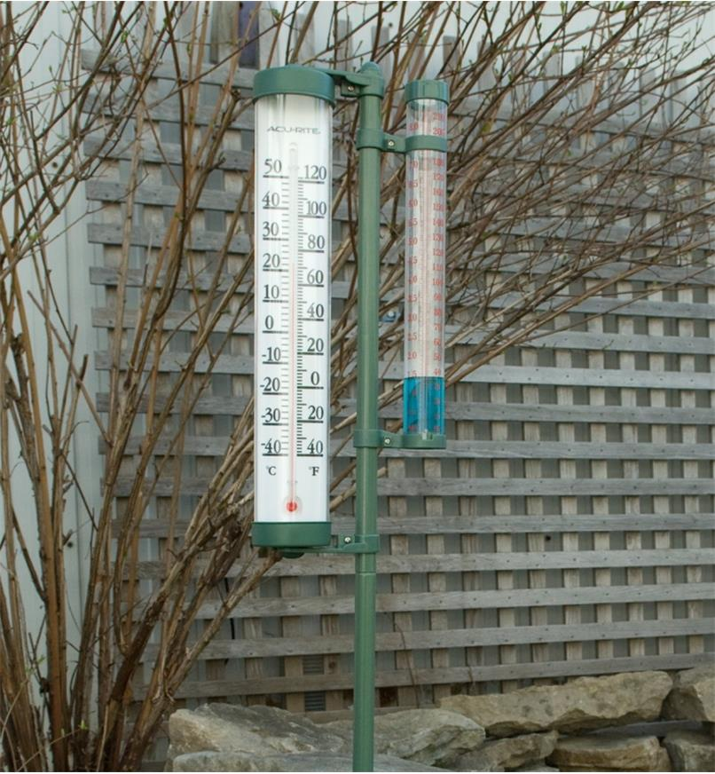Rain Gauge with Thermometer mounted in a yard