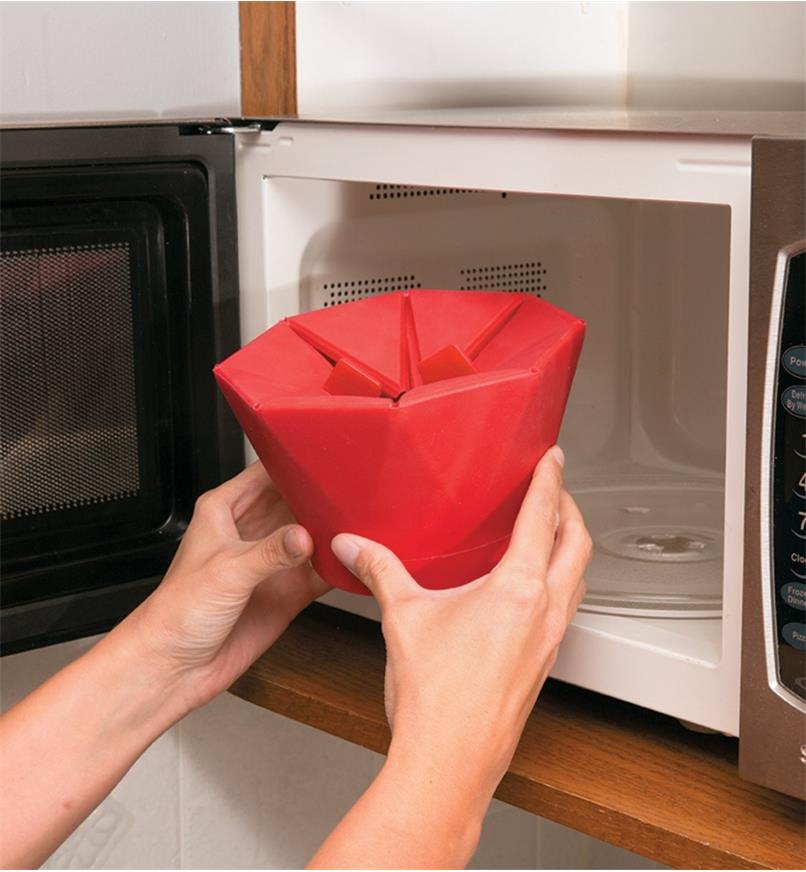 Placing the closed Poptop Popcorn Popper in the microwave