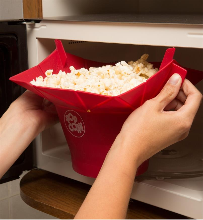 Removing the Poptop Popcorn Popper filled with popped popcorn from the microwave