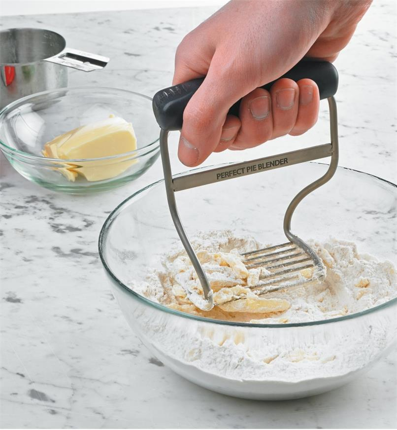 Blending butter and flour in a bowl using the Pastry Blender