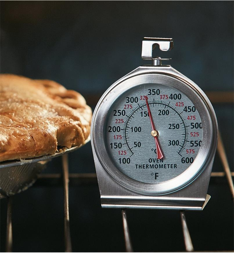 Oven Thermometer on an oven rack beside a pie