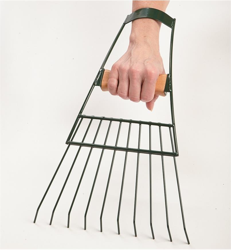 One Large Hand Rake held in a hand