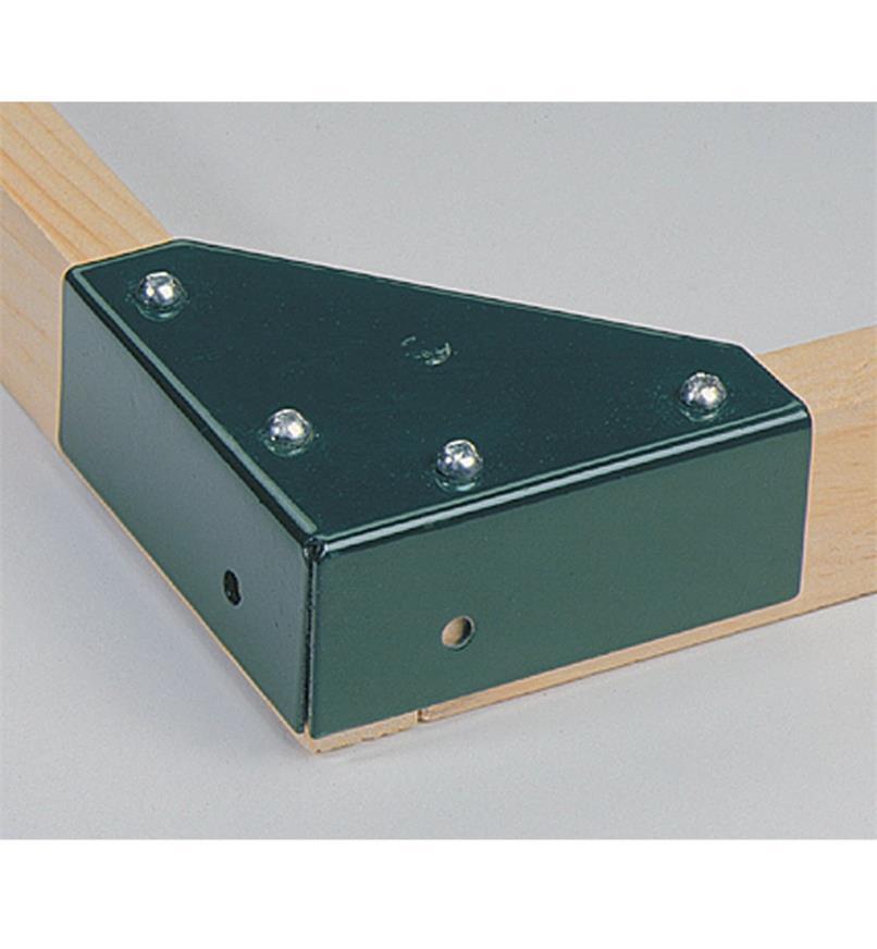 Top Kit corner bracket fastened to wood