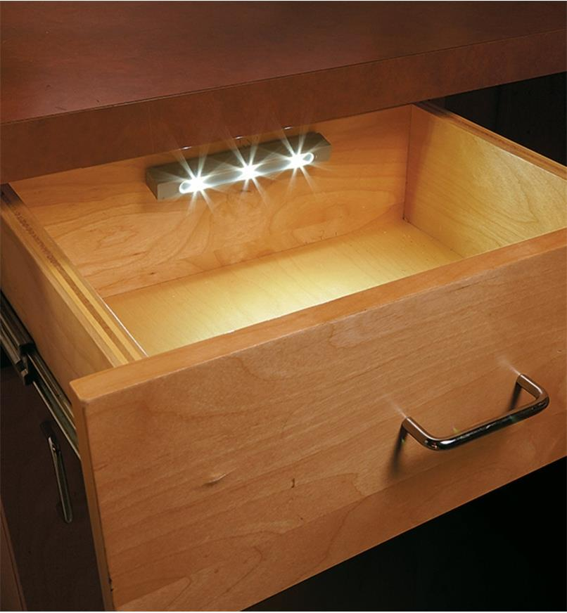 Example of drawer light mounted to the inside back of a desk drawer