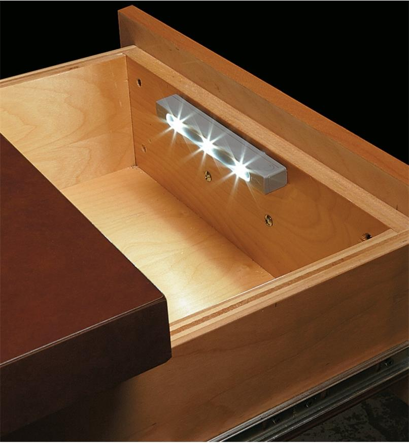 Example of drawer light mounted to the inside front of a desk drawer