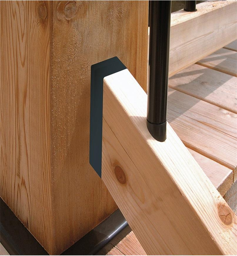 A deck stair railing connected to a post with a stair rail connector