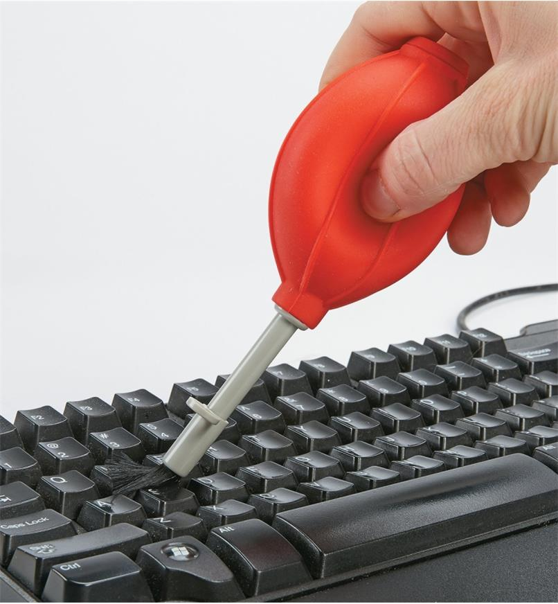 Silicone Dust Blower cleaning dust from a keyboard
