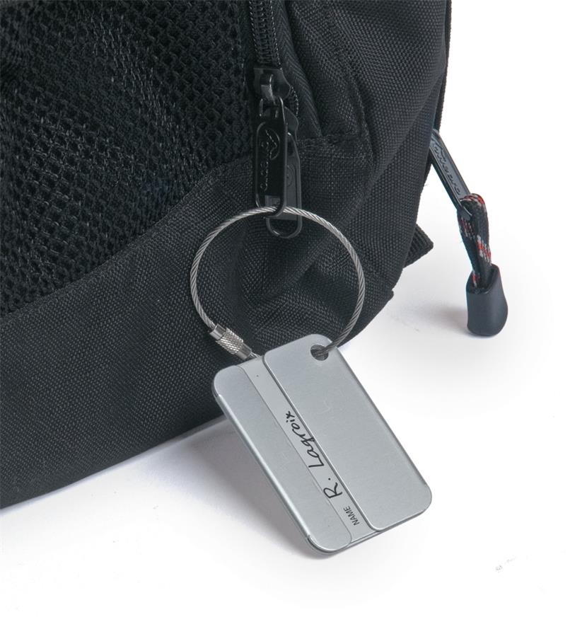 Security-Style Luggage Tag attached to a bag zipper