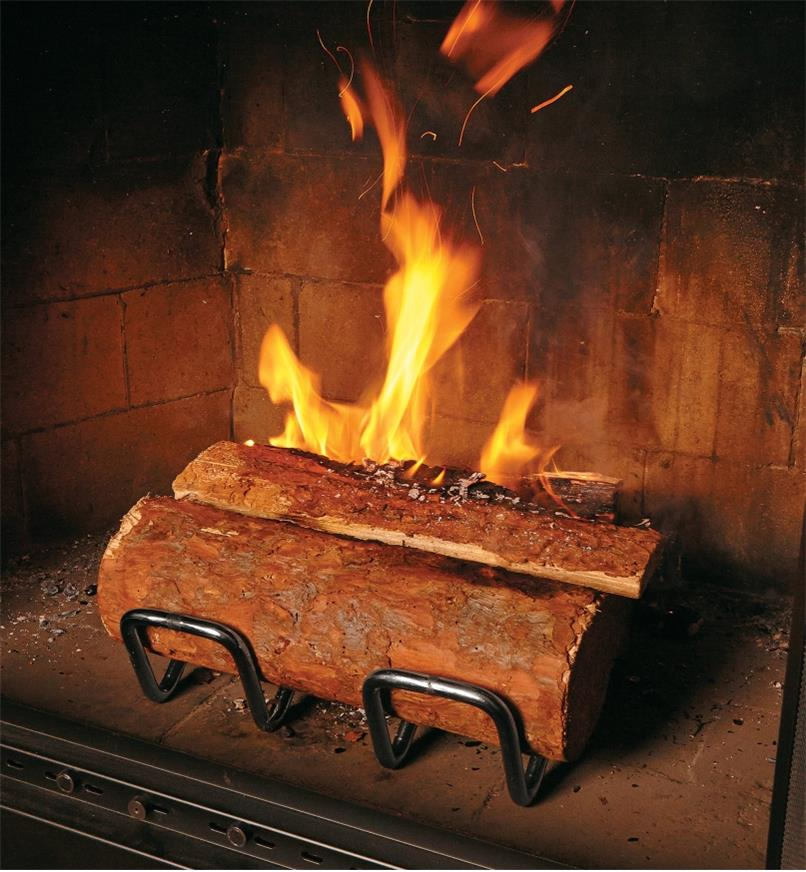 Stainless-Steel Andirons in a fireplace, holding logs that are burning