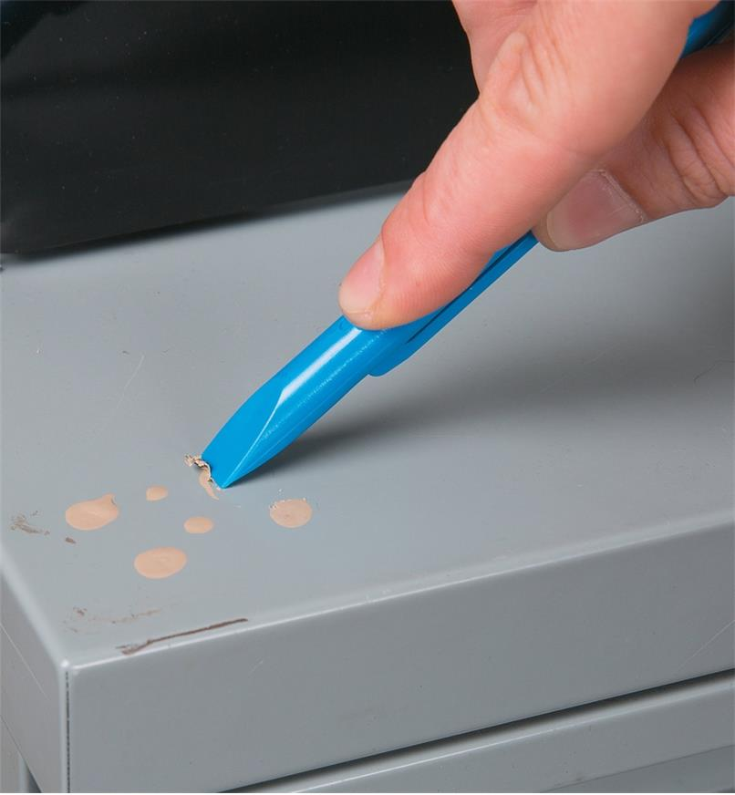 Using a Scrigit Scraper to remove paint splatter