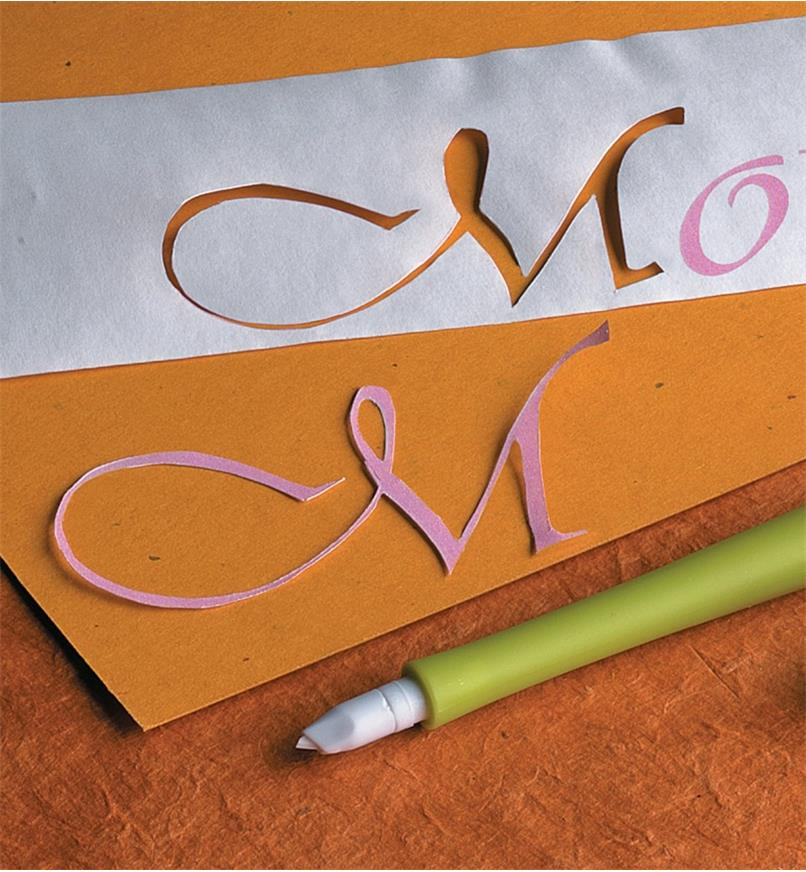 Cursive letter M cut from paper using the Slice paper cutter