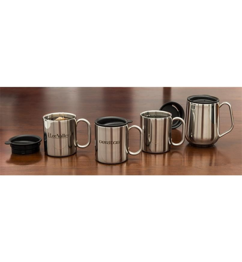 One of each of the Stainless-Steel Insulated Mugs filled with hot beverages