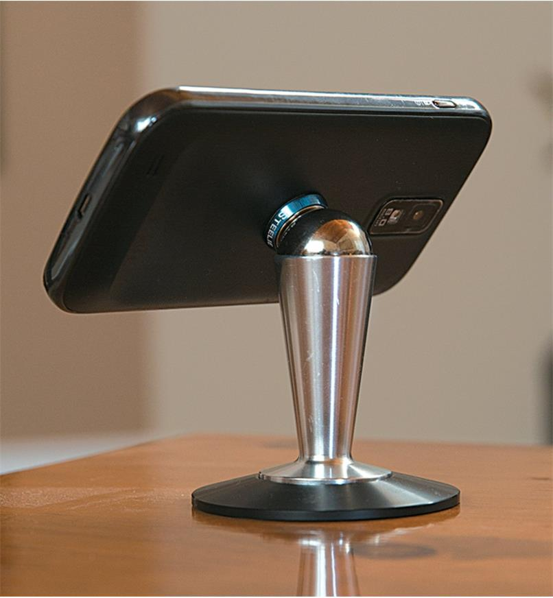 Phone attached to desktop pedestal, rotated to landscape orientation