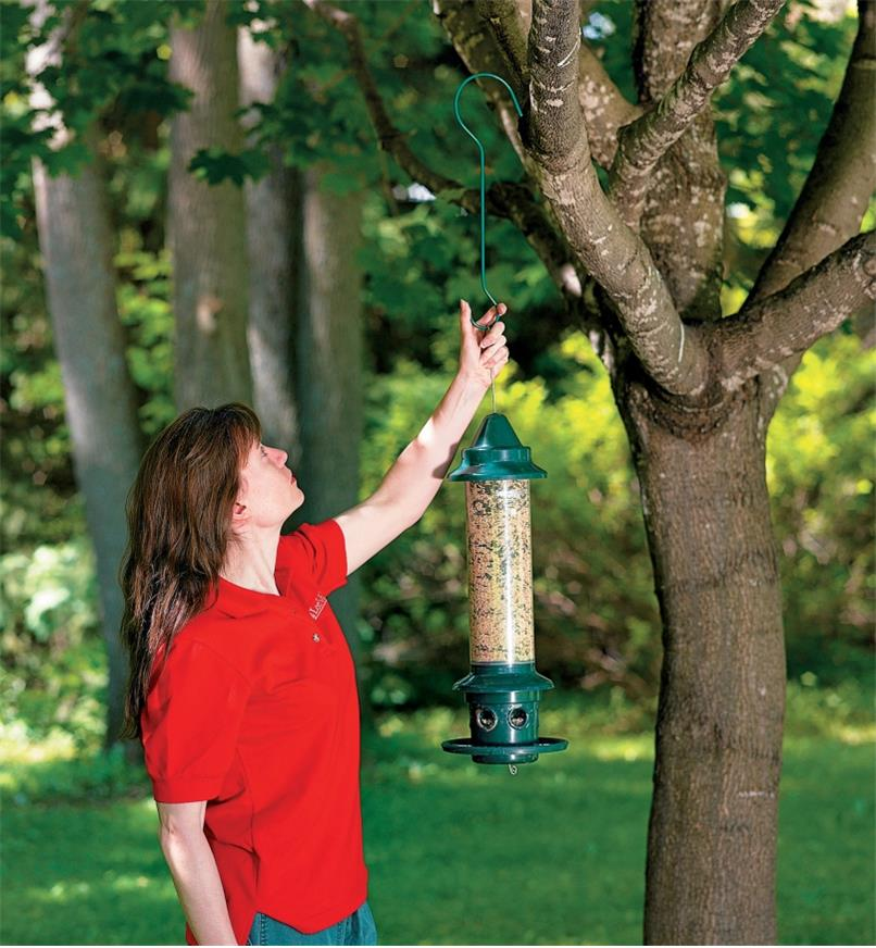 Hanging a Squirrel Buster Plus Feeder in a tree using a garden hook