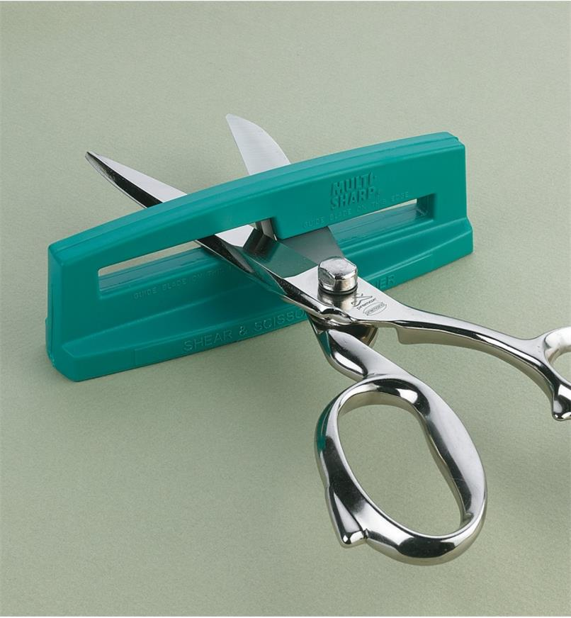 Scissors inserted in sharpener