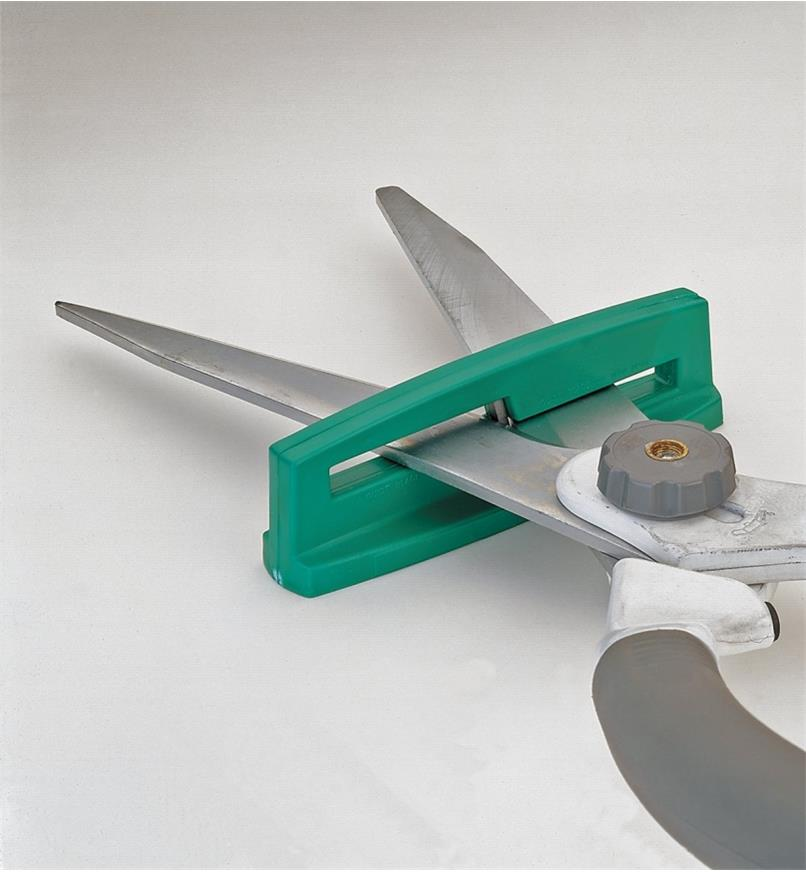 Shears inserted in sharpener