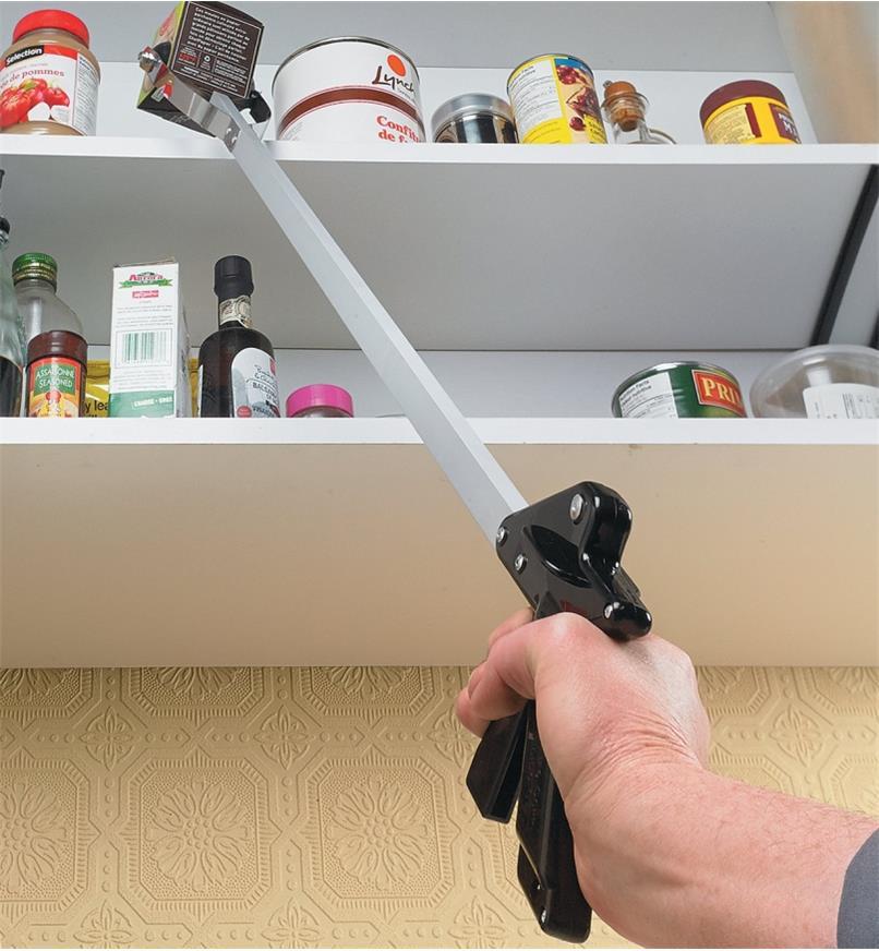 """Reaching an item on a high shelf using the 40"""" Soft-Touch Gripper"""