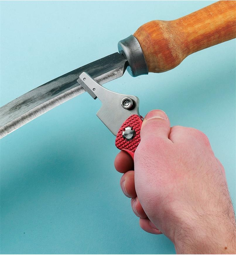 Universal Sharpener being used to sharpen a curved blade