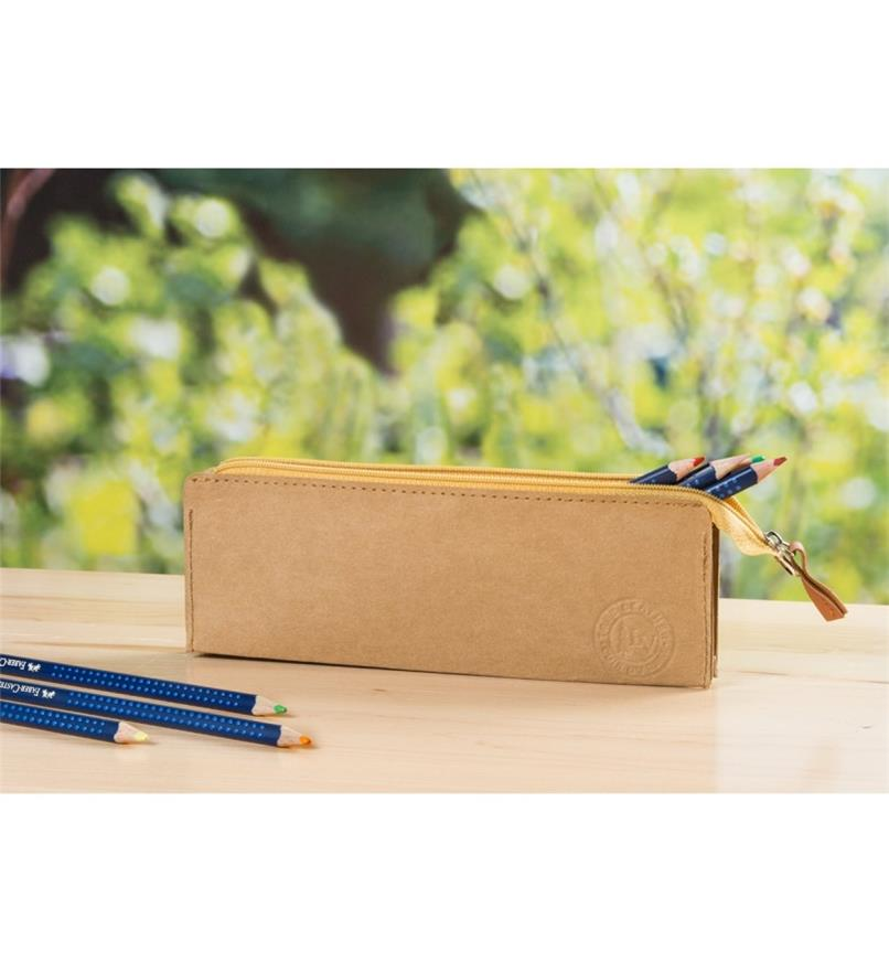 Tree Leather Zippered Pouch on a desk holding colored pencils