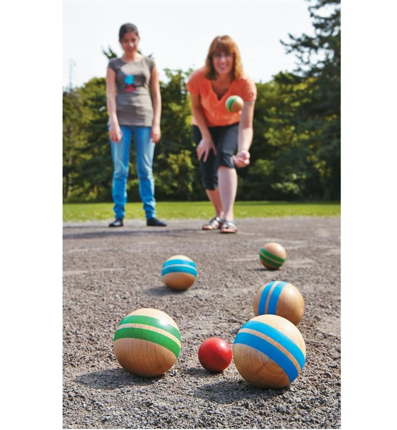 Two women playing Pétanque