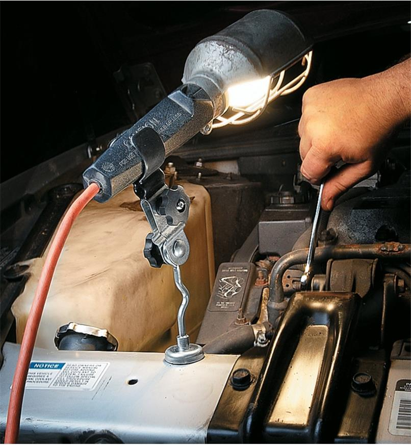 Flashlight holder affixing a trouble light under a car hood