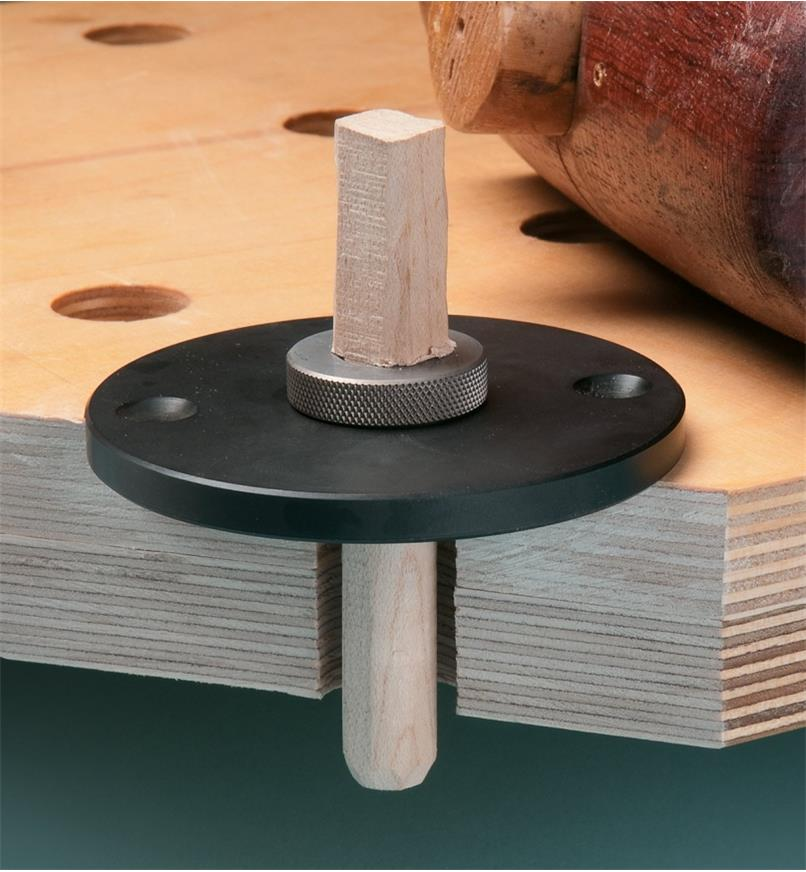 Cutaway view through a benchtop showing a dowel being formed in the dowel former