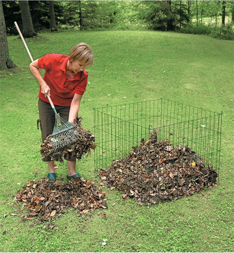 A woman uses a rake to transfer leaves to a Wire Compost Bin