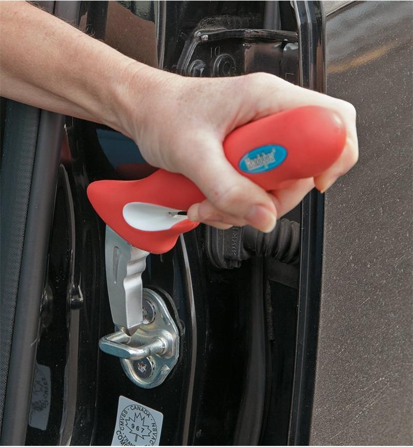Handybar fits into the U-shaped striker plate in the car's door frame