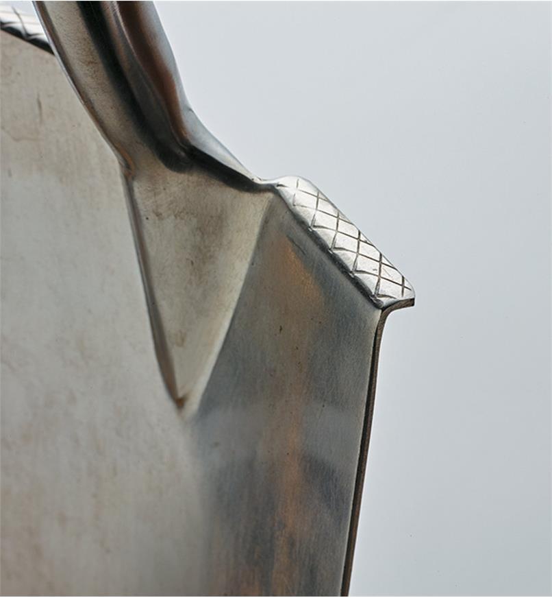 Close-up of folded steps on Ergonomic Ash-Handled Digging Spade