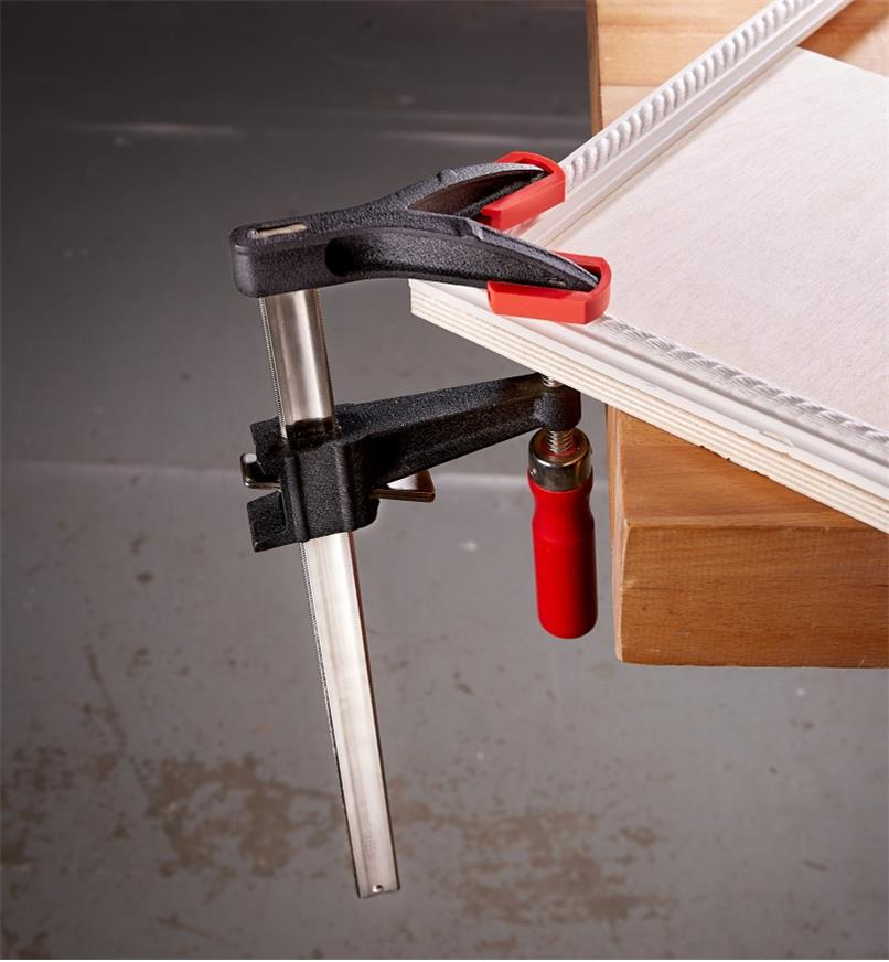 A Bessey double-jaw FA clamp used to hold the mitered corner of a picture frame