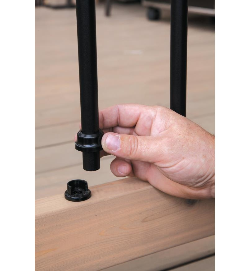 Snapping in a baluster and sliding the collar over the base