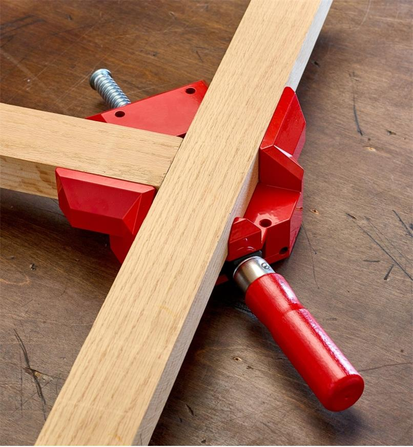 A Bessey corner and T clamp being used to hold a T joint