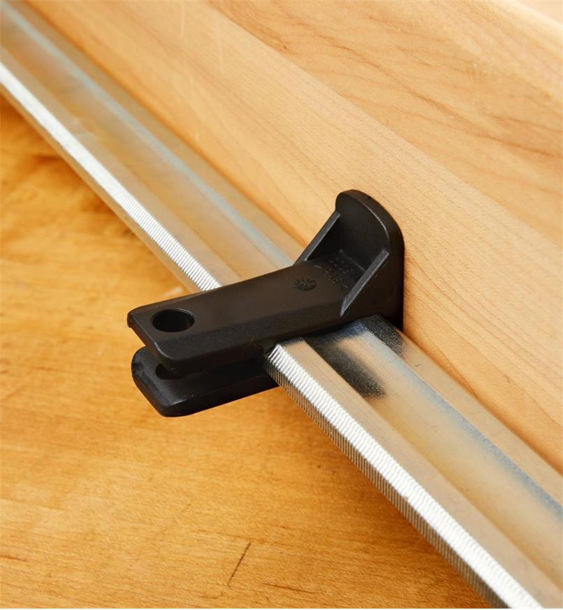A Bessey K-Body rail protector mounted on a K-Body clamp rail