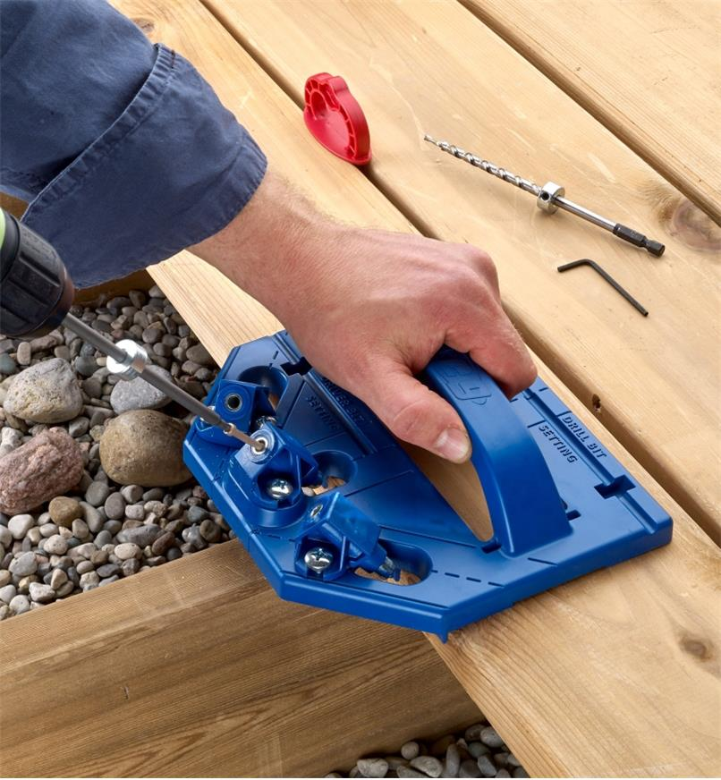 Driving a screw into a deck board with the Kreg Deck Jig