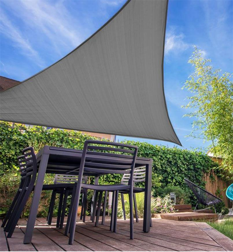 Underside view of a triangle shade sail providing shade on a patio