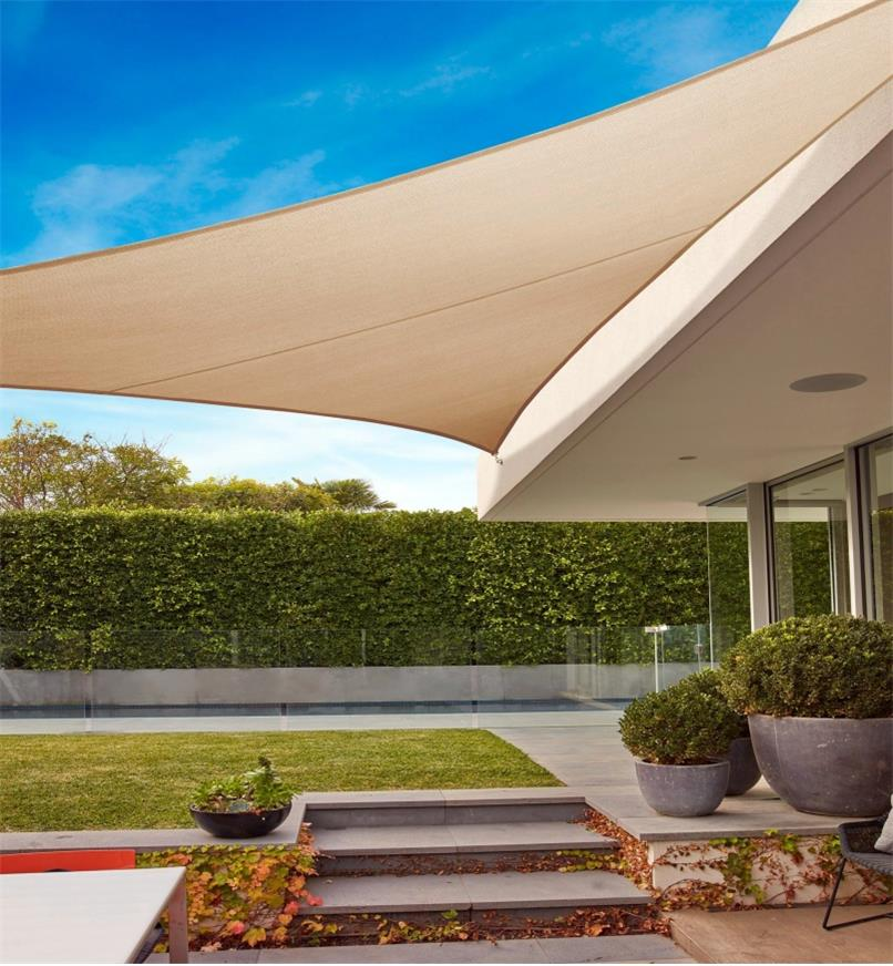 A triangle shade sail shades a walkway