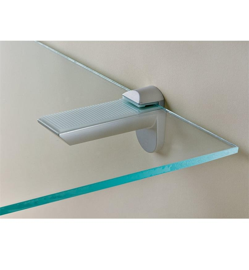 Silver-finish shelf holder holding a glass shelf