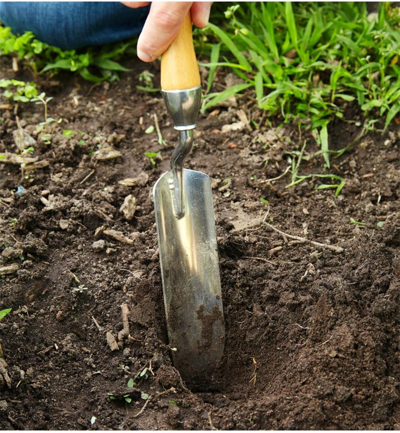Digging in garden soil using the Lee Valley Premium Narrow Trowel