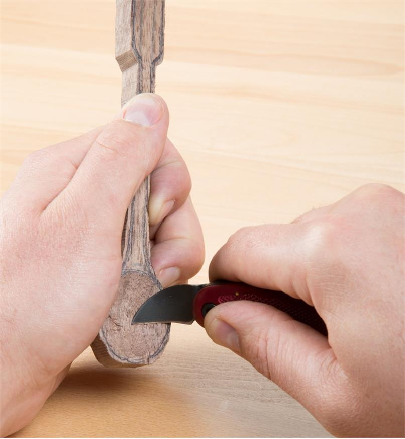 Using a Flexcut Spoon Carving Knife to hollow the bowl of a wooden spoon