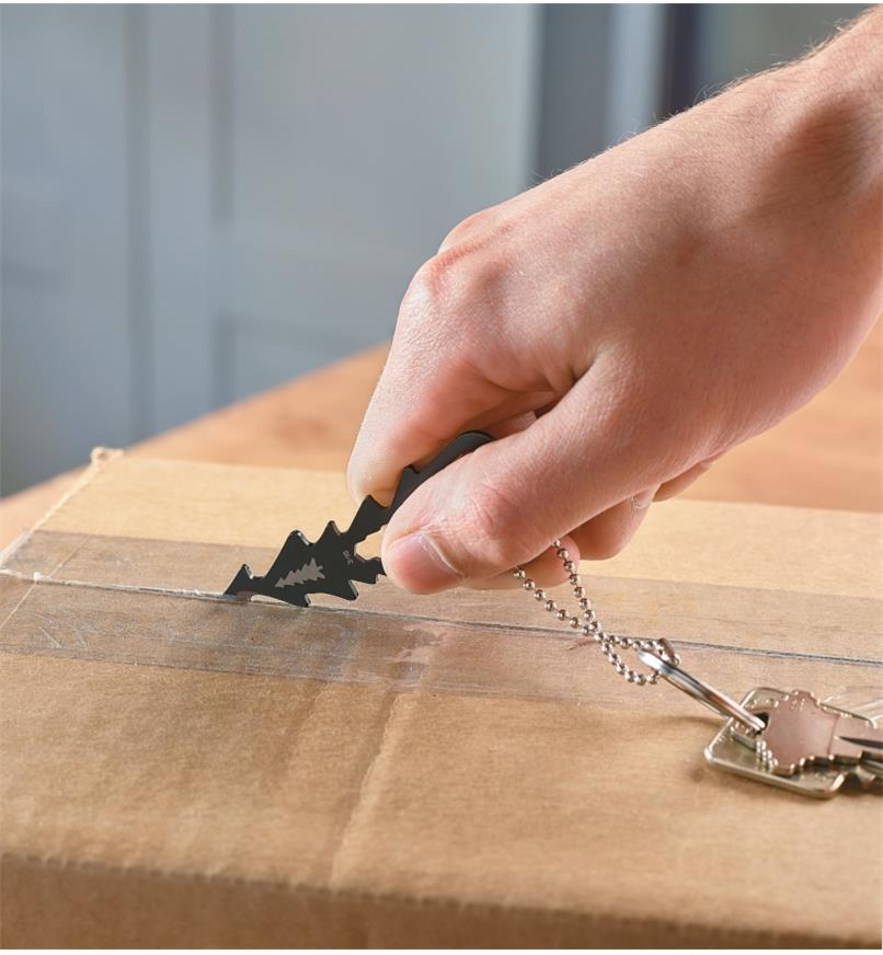 Using the Lee Valley Key-Chain Multi-Tool to cut the tape sealing a cardboard box