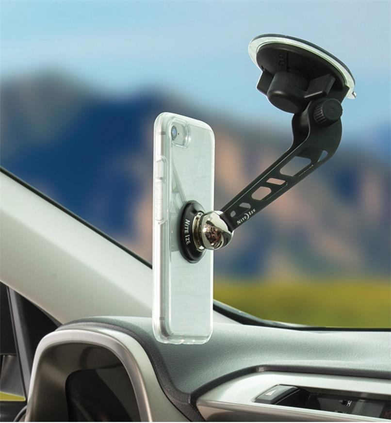 Windshield-Mount Kit installed on a car windshield with a cell phone attached