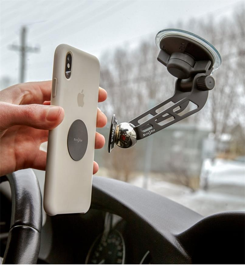 Attaching a cell phone to a Windshield-Mount Kit installed on a car windshield